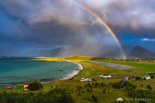 Crazy storm clouds and a rainbow over Fredvang and Ytresand beach