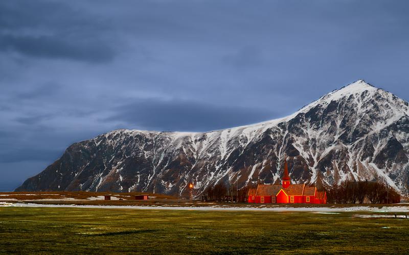 Flakstad Church in Lofoten landscape.