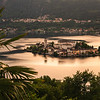 Beautiful sunset over San Giulio island, a jewel that can be visited daily by boat in lake Orta, Piedmont