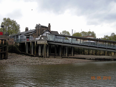 Low tide on the Thames river . Drops about 20 to 30 ft.