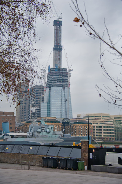 Cruiser HMS Belfast in front of the Shard, Western Europes future tallest building