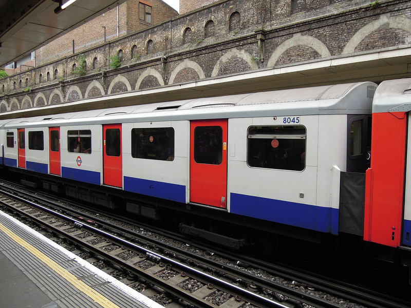 London: Train at Sloane Sq station, 2011