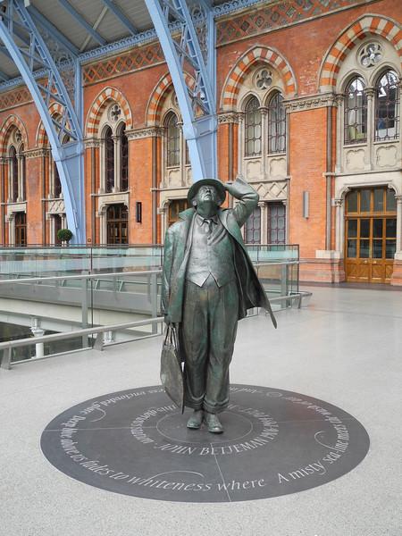 London: Sir John Betjeman admiring the station roof