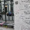 """Graffiti on gate post at <a href=""""https://en.wikipedia.org/wiki/Abbey_Road_Studios"""" target=""""_blank"""">Abbey Road Studios</a>"""