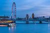 London Eye and scaffolded Big Ben at dusk