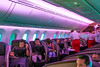 Virgin Atlantic First Class seating. The sitting seats disappear and a bed unfolds flat on tp of where tye sitting seat had been. The attendant then makes the bed with a mattress pad, duvet and down pillows. Pajamas are offered.