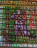 St. Michael's (Dick Whittington's) Church Stained Glass. Image of Dick Whittington and his famous cat. (Arrow points at cat.)