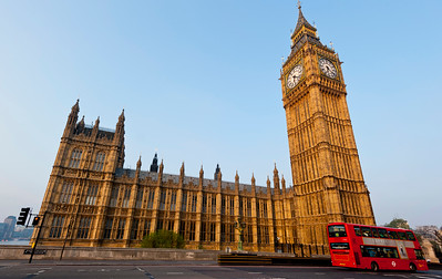 The Houses of Westminster, the UK Parliment, with the famous clock tower Big Ben and a red London bus.