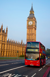 A red, double decker London bus in front of the Houses of Westminster, the UK Parliment Buildings