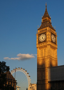 Big Ben with the London Eye Ferris Wheel at sunset.