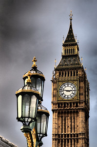 Big Ben with a streetlight in front.