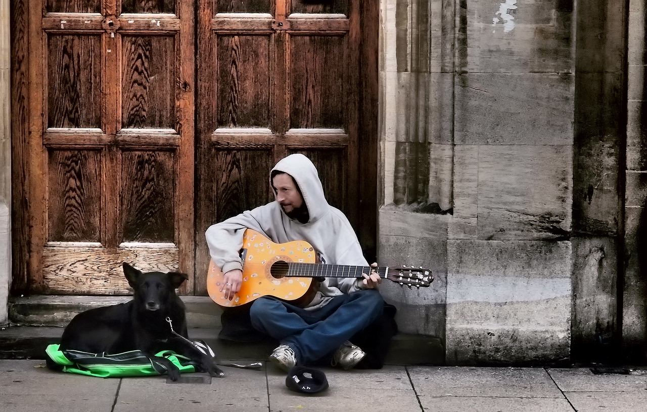 A street performer and his dog in Cambridge, England.