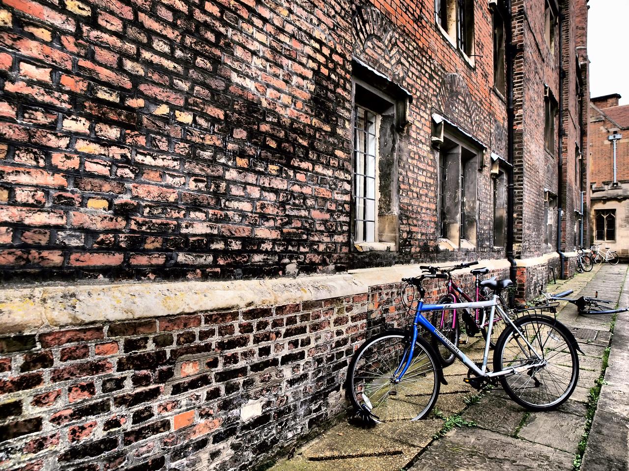 A bike parked on a side street in Cambridge.