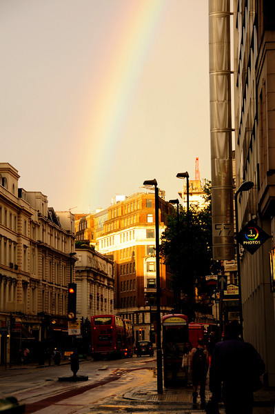 street scene in London with rainbow