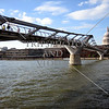 The Millennium bridge over the Thames River and St Paul Cathedral in London, England.