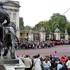 Visitors gather in front of Buckingham Palace during the changing of the guards ceremony in London, England.