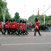 Royal Guards march in front of Buckingham Palace in London, England.