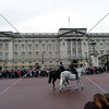 Visitors waiting for the change of guards in front of Buckingham Palace in London, England.