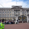 The Buckingham Palace and visitors waiting during the change of the guard ceremony in London, England.