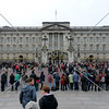 Visitors waiting for Change of the Guards at Buckingham Palace in London, England.