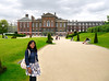 Susie in front of Kensington Palace.