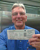 Me with my boarding pass for my flight to London.