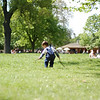 Michael playing in the grass with his sticks in Hyde Park.