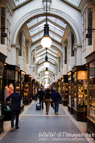 An arcade - covered shopping - in the Bond St vacinity.