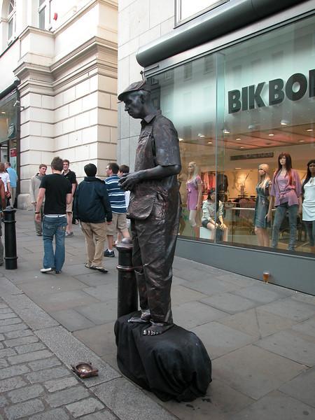 Street artist. Really looked like he was 'bronzed'.. Look behind him: his beer.....