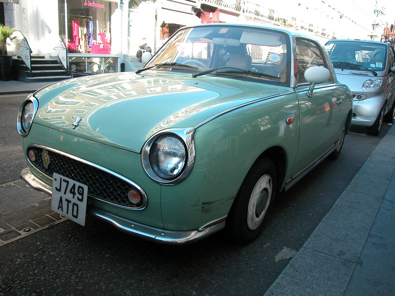 A Nissan 'Figaro'. Small 'retro' car, introduced on the 1989 Tokyo Motor Show. They made it look like the 1960 Datsun Fairlady. Very well maintained.