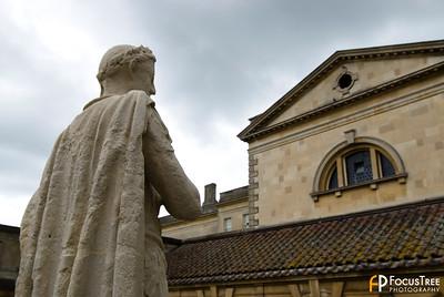 Statue overlooking the Roman Baths
