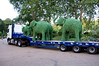 A truck load of green elephants