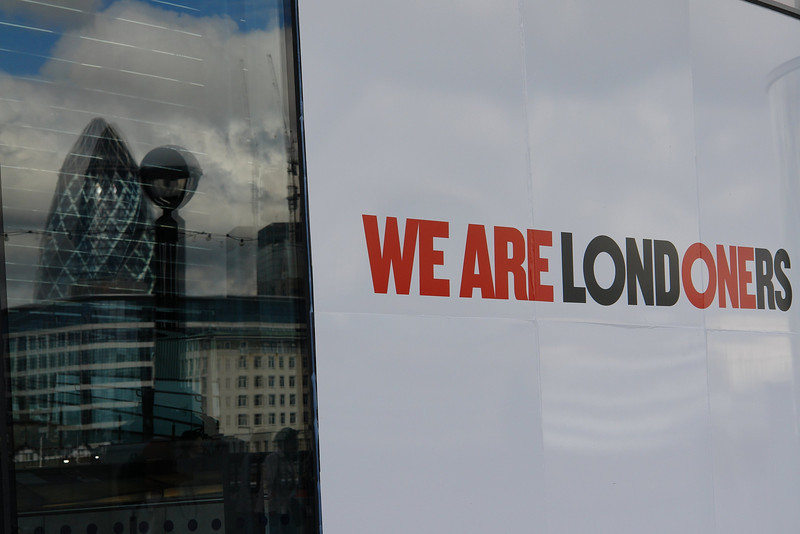 We Are Londoners. A poster on the window of City Hall with the 'Gerkin' reflected.