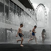 Splash! 1.<br /> Children playing in 'Appearing Rooms' installation by artist Jeppe Hein on the Riverside Terrace,infront of The Royal Festival Hall on the Southbank.