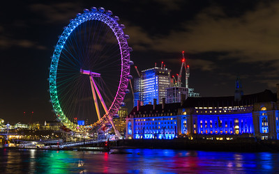The London Eye, illuminated in rainbow colours, night long exposure