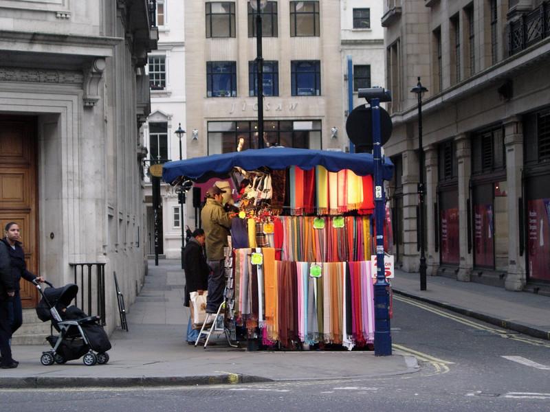 A street vendor displaying his wares. London England
