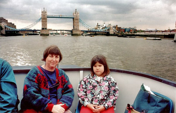 Gill and Lan, on the Thames past Tower Bridge London England - Jun 96