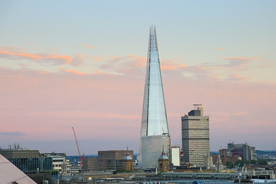 The Shard of London and surrounding city skyline in soft pink sunset light, London UK
