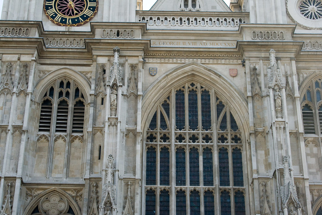 The facade of Westminster Abbey. Notice the name inscriptions above the arch. Talk about history.