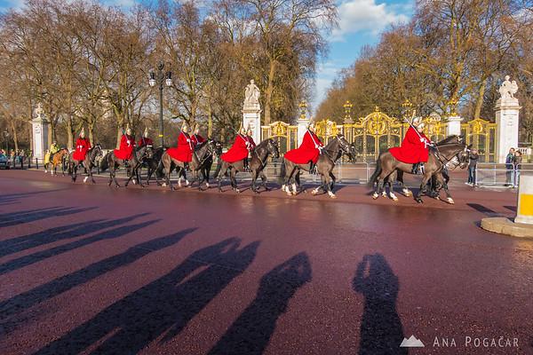 Horse guards riding past the Buckingham Palace, London