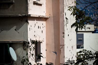 Most walls of buildings that were not bombed during the Lebanese civil war are riddled with bullet holes.