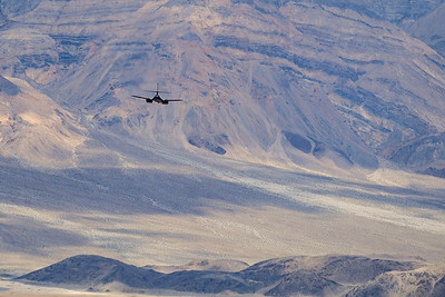 B1-B bomber heading out over the Panamint Valley from Star Wars Canyon, Death Valley NP.