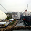 Cruise terminal and Queen Mary ship docked at the port in Long Beach, California.