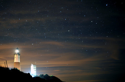 Montauk Lighthouse at night, high clouds