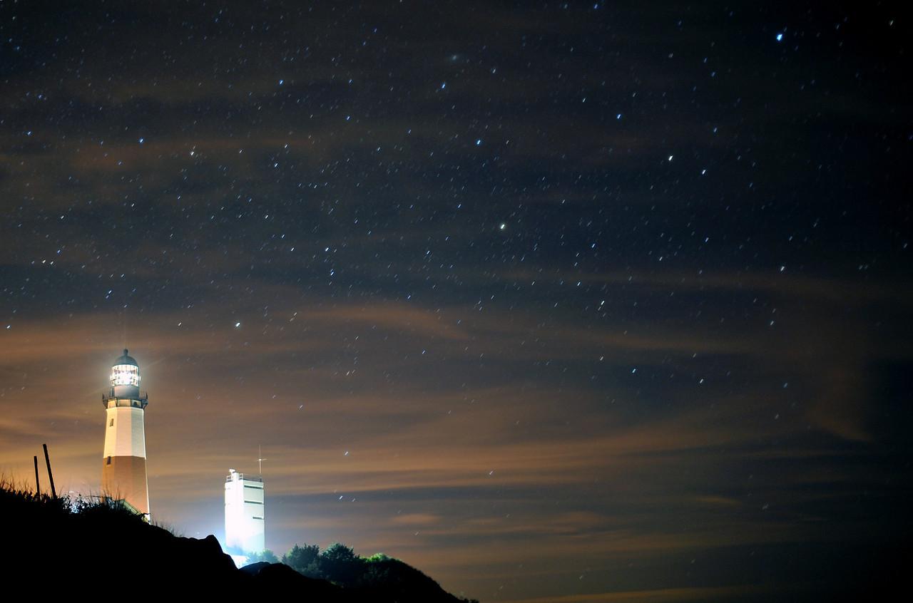 Montauk Lighthouse at night, high clouds