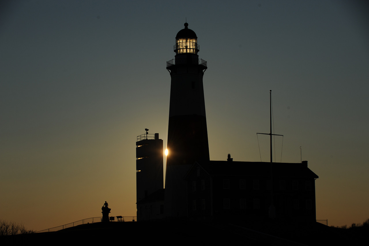 Sunrise reflecting through the dome of the Montauk Lighthouse.