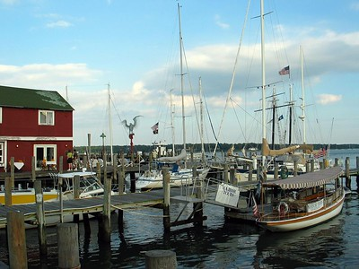 Greenport docks. In the right foreground is the harbor cruise ship, GLORY. It is a reproduction, built in 1990, of an electric launch originally built in 1893. you can read more about it here: http://www.greenportlaunch.com/about.html