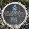 The plaque set on the top of the ridge where the aircraft first struck the ground.