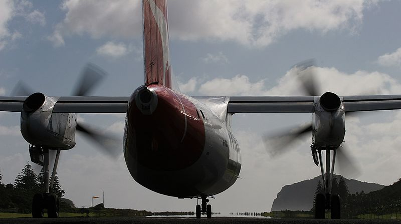 A Qantaslink DHC-8-200 lines up for take off at Lord Howe Island. The prop-wash and turbine efflux as the pilot brought the PW 123s up to full power blew off my glasses and nearly knocked me over. Dumb to stand on the grass verge but I got the shot!