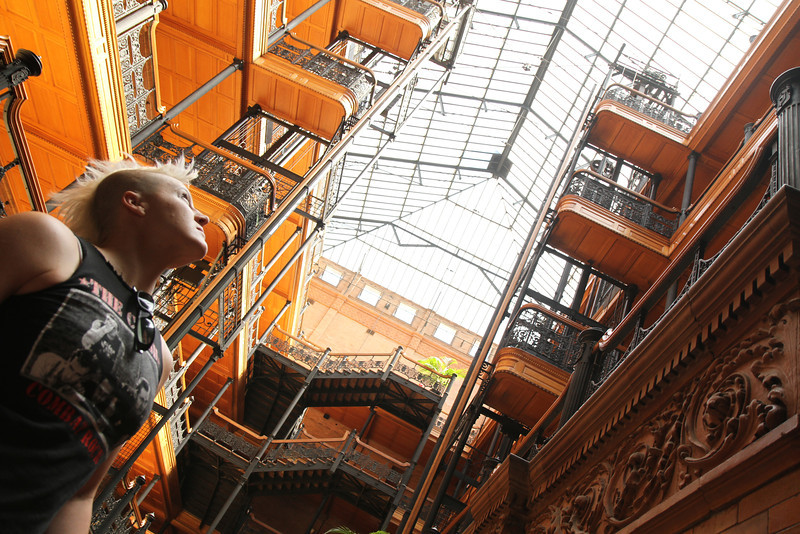 Atalee basking in the glow of the Bradbury Building atrium. Downtown Los Angeles, August 29, 2011.